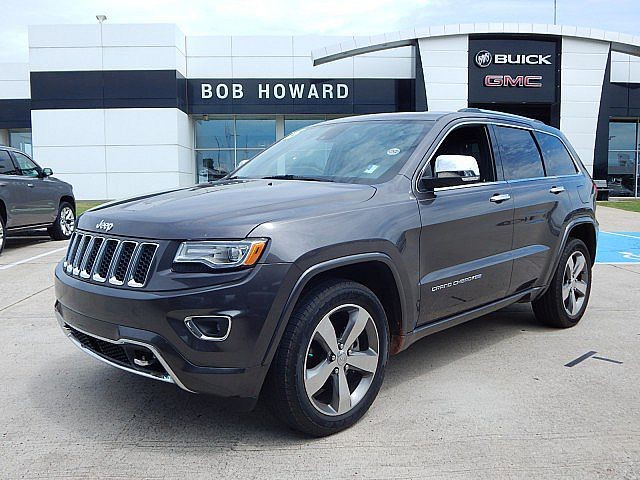 "Pre-Owned 2015 Jeep Grand Cherokee Overland 4X4 | BOB HOWARD BUICK GMC 405.936.8800 | CLEAN CARFAX | NAV | MOONROOF | 20"" WHEELS 
